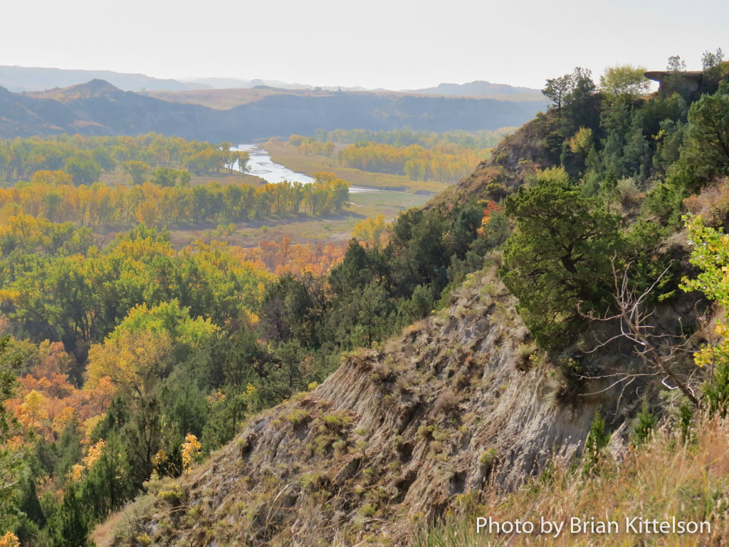 Looking over the Little Missouri River on a smoky fall day, brilliance glows.