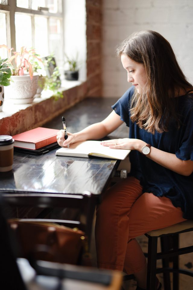 woman journaling the question you should be asking