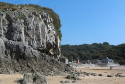 Cliffs and beach cafes, Caswell Bay, Gower