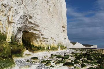 Natural cave in chalk cliffs, beach, Seven Sisters