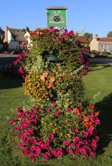 Flower display, village sign, Cavendish