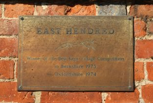 Best Kept Village Competition plaque, on wall of Champs Chapel, East Hendred