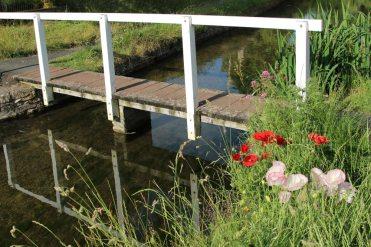 Wooden footbridge across River Eye, Lower Slaughter