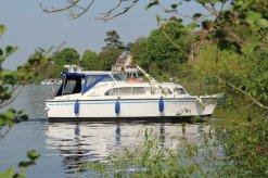 Boat entering Walton Marina, River Thames, Walton-on-Thames