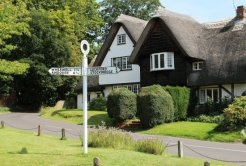 Chilbolton Cottage and village signpost, Chilbolton