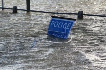 Police Road Closed sign, flooded Thames Side, Laleham. Floods February 2014