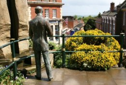 Bronze statue of Sir Edward Elgar, looking down Church Street, Great Malvern