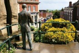 Bronze statue of Sir Edward Elgar, looking down Church Street, Great Malvern