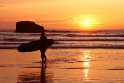 Sunset, Chapel Rock and surfer, Perranporth