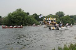 Olympic Torch flotilla. Olympic Torch, The Gloriana, River Thames, Richmond. 27th July 2012