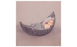 photo of baby boy in a wicker moon basket