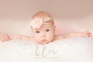 beautiful little moments baby with floral tieback