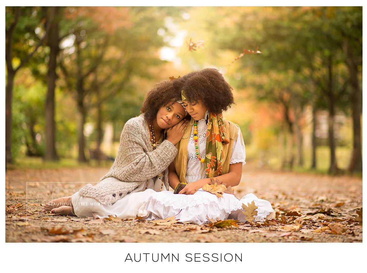 sisters sat in autumn scene