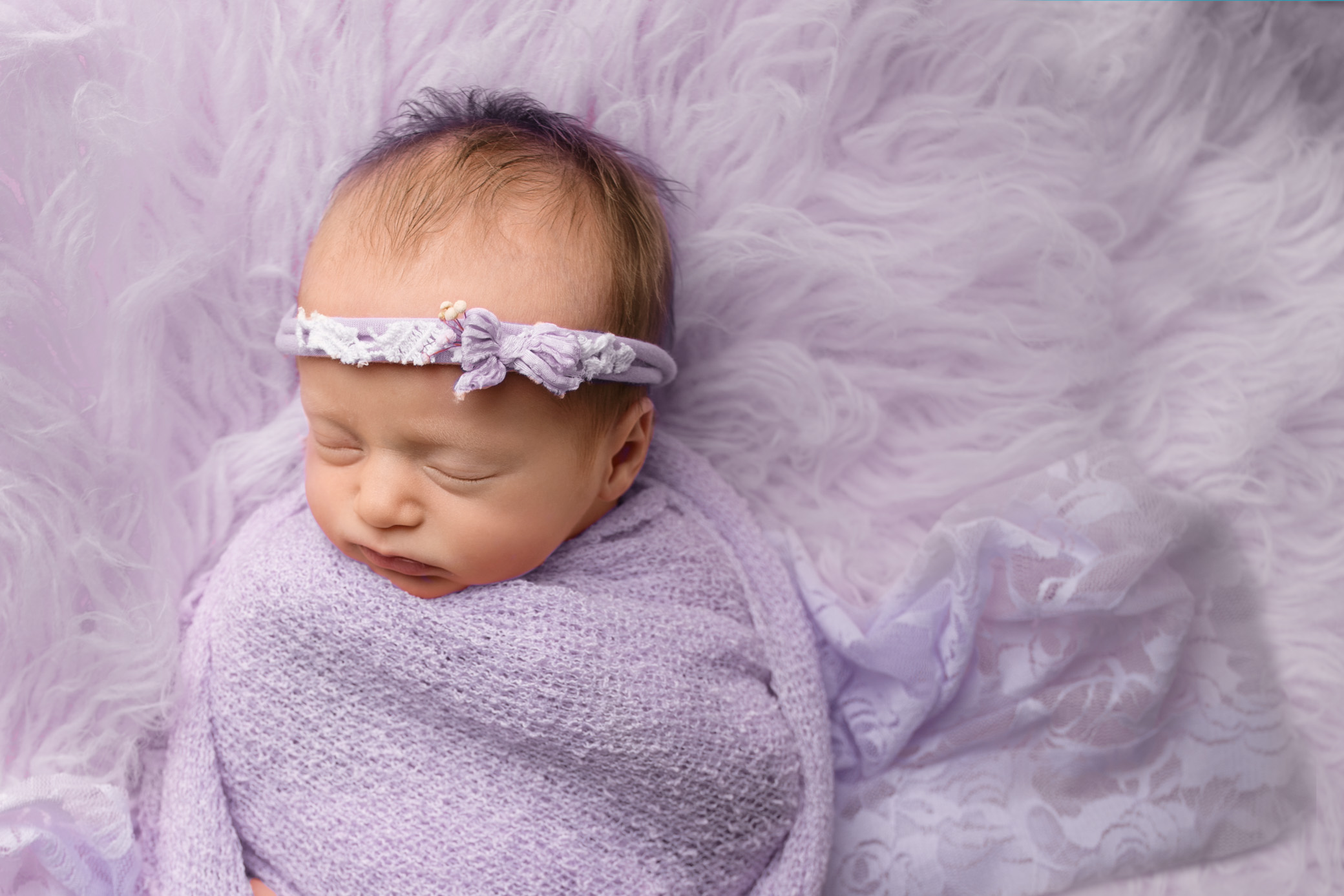 newborn baby girl studio photo session epsom wrapped in purple floral headband