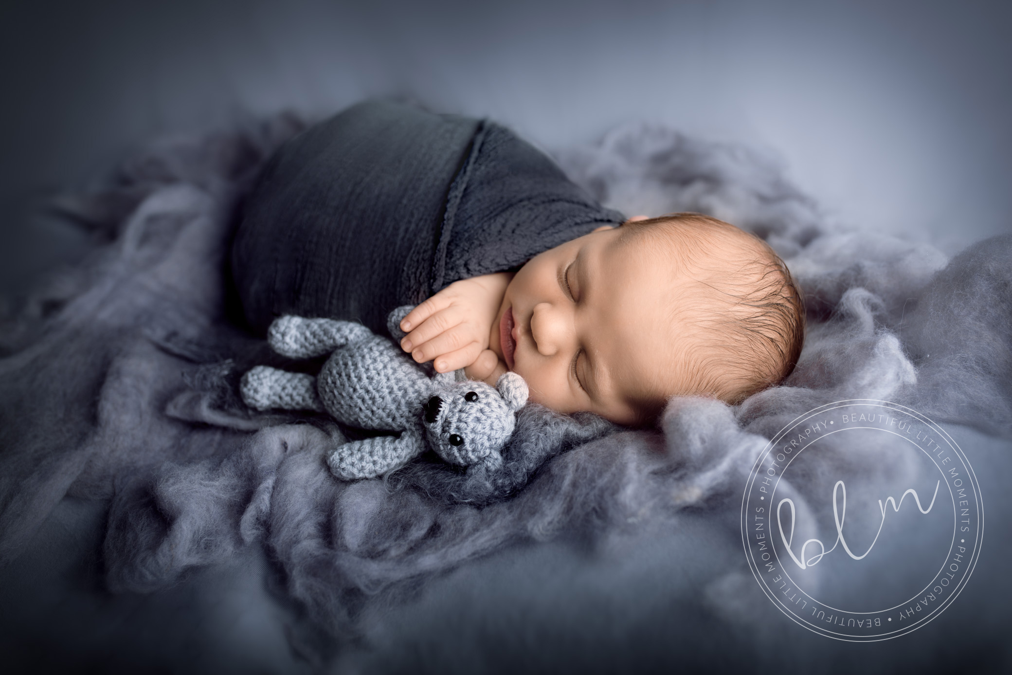newborn-boy-grey-wrap-with-bear-1