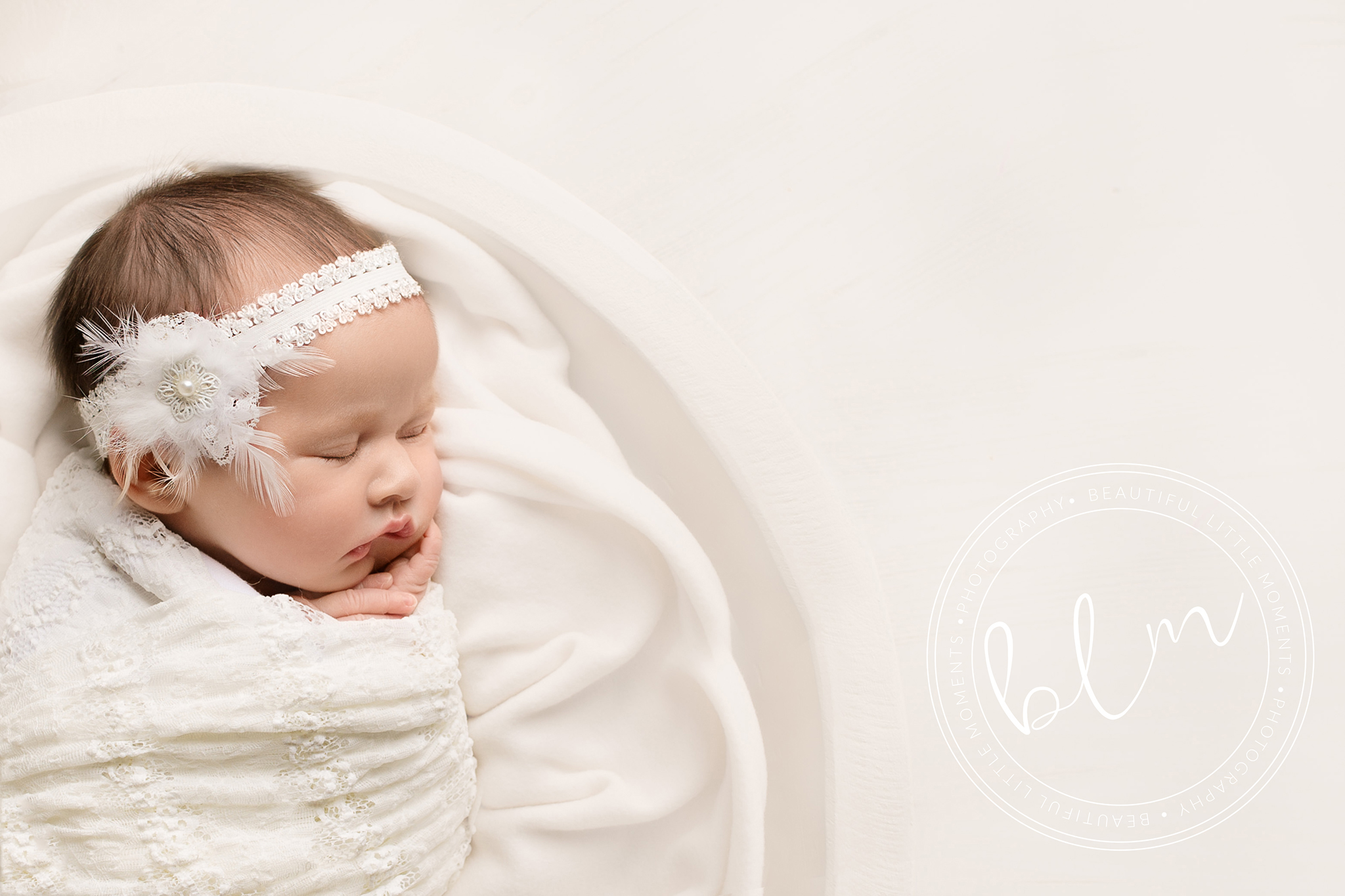 newborn baby girl photo shoot baby wrapped in white