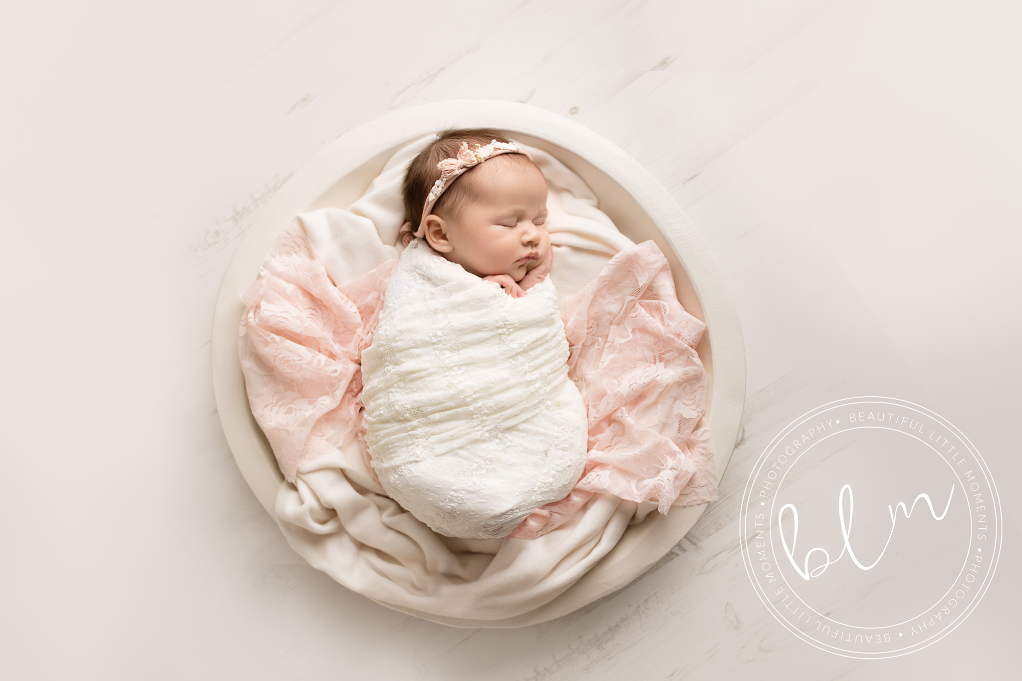 newborn baby girl wrapped in lace