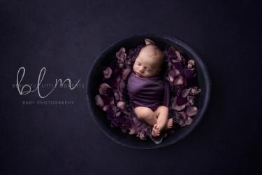 newborn-boy-purple-bowl-flowers-crop