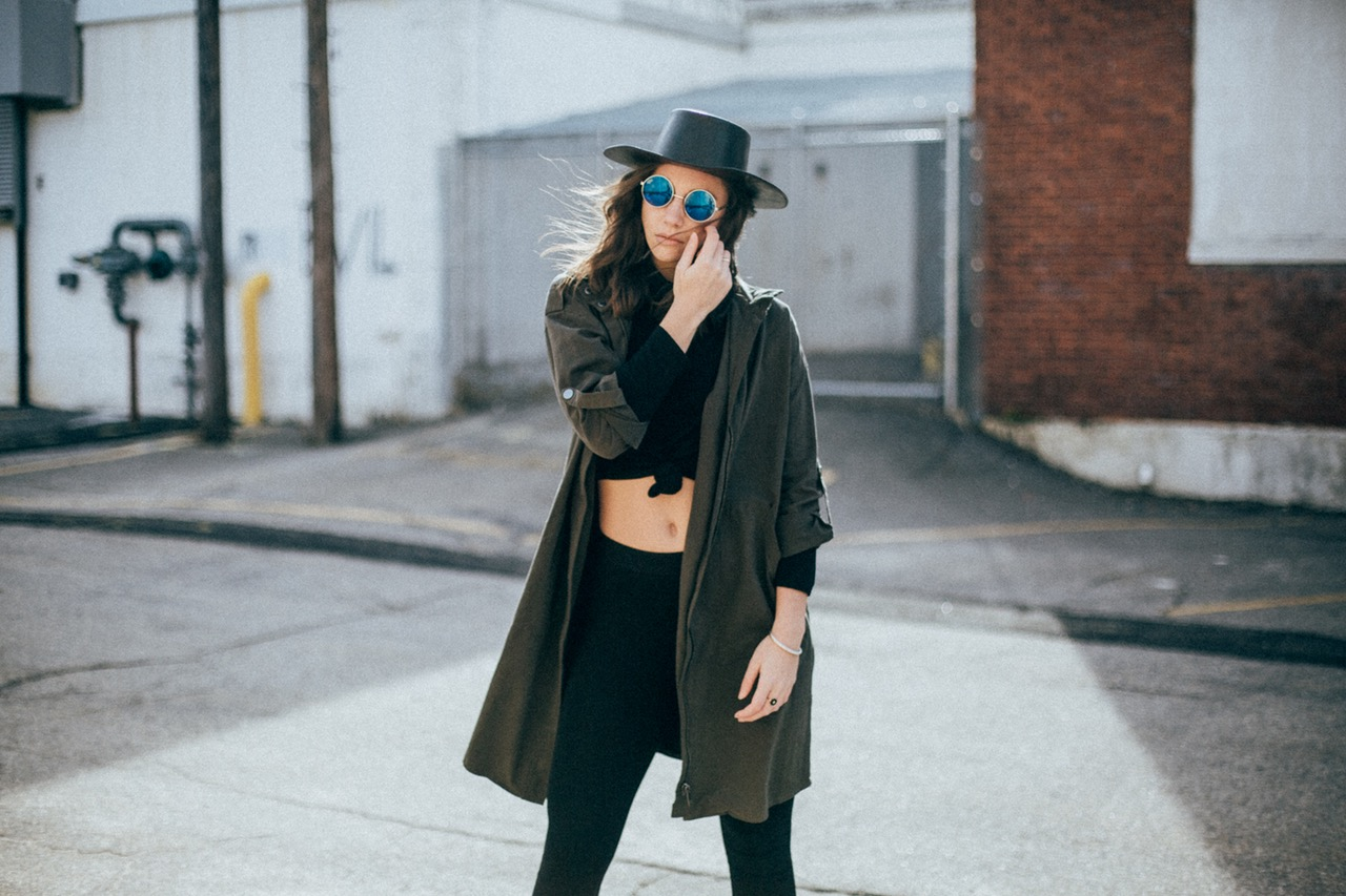 stylish girl with hat and glasses