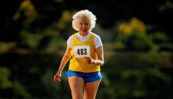 Mature woman running in race