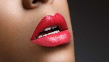 closeup shot of full sexy woman lips with red lipstick. copyspace.