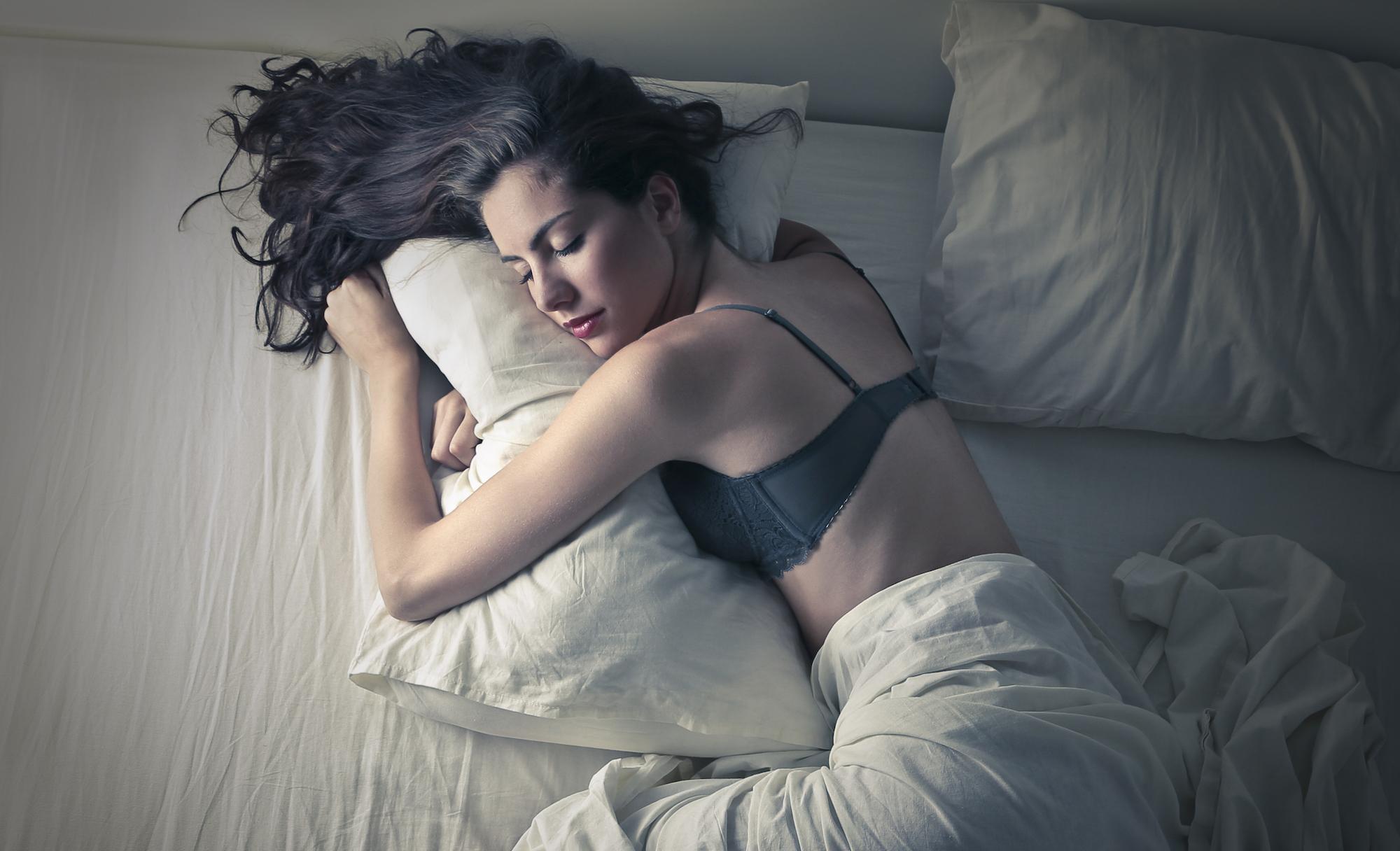 young-woman-sleeping-PVKBCPB