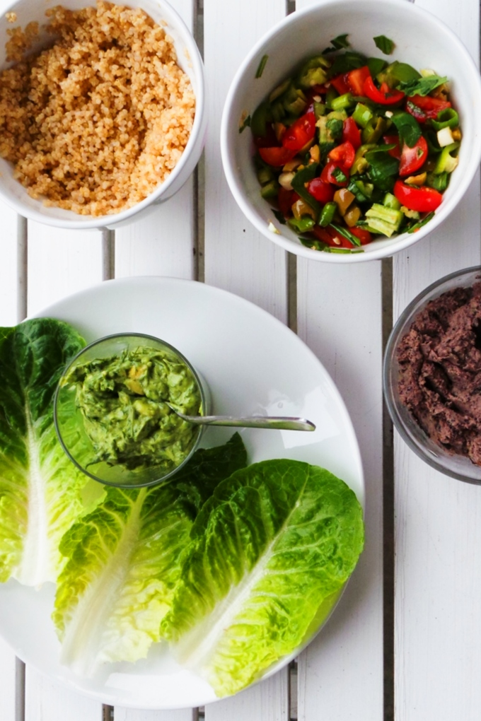 Vegan lettuce wraps with a spicy bean dip, avocado, quinoa and vegetables! Delicious and light vegan dinner recipe!