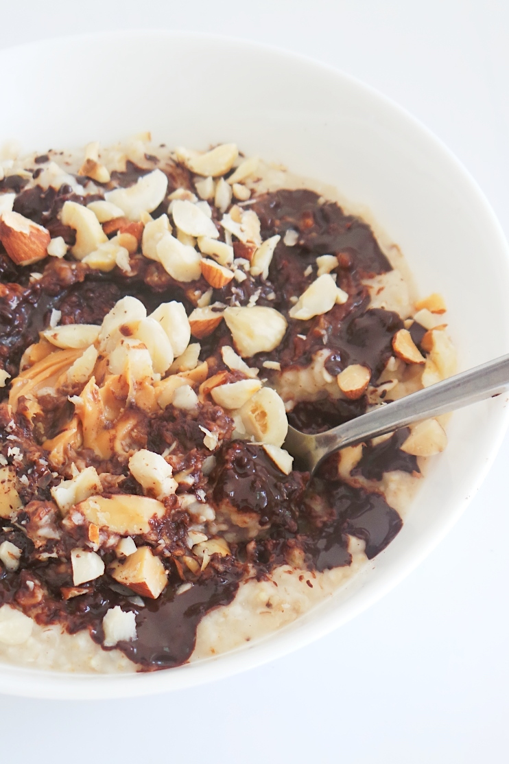 Healthy Peanut butter and chocolate oatmeal! Super easy healthy breakfast that I often misuse as dessert. This healthy vegan breakfast will warm your heart and will make you full for a LONG time! Comes together in minutes