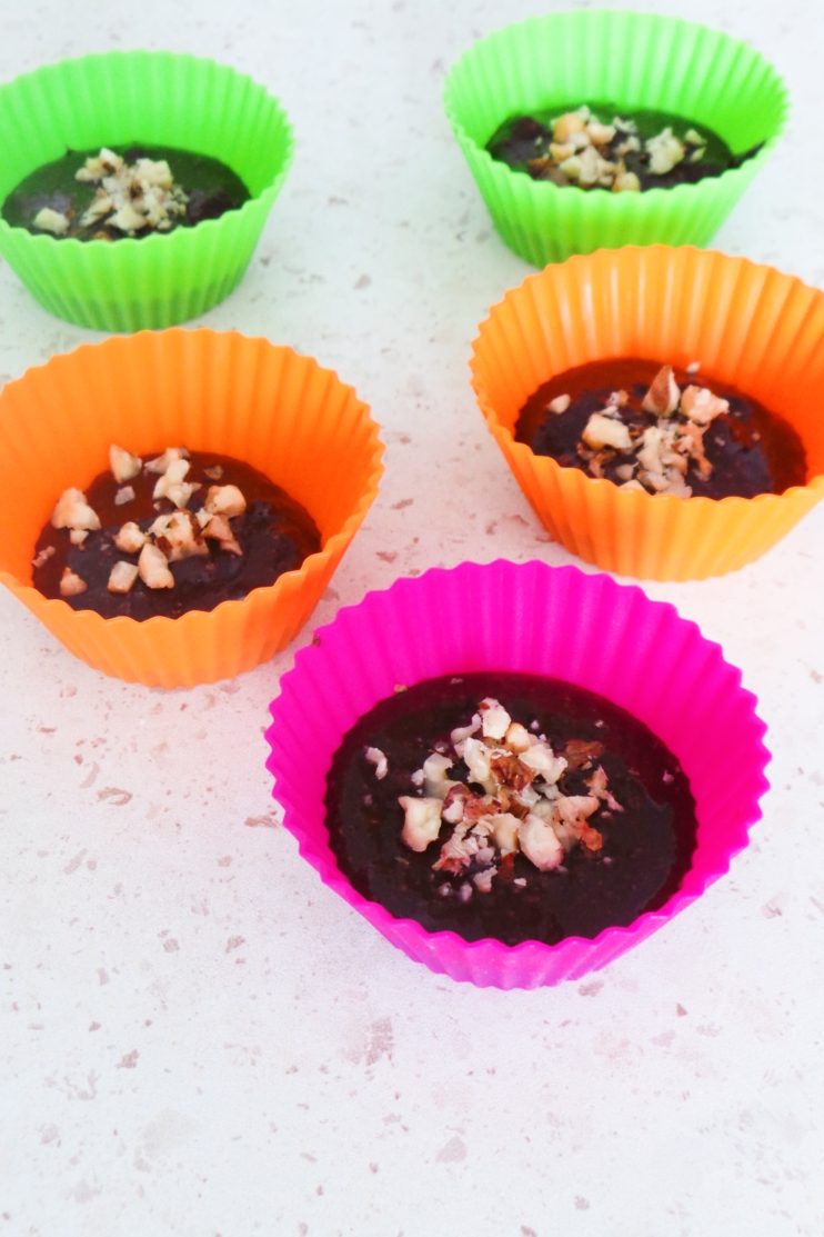 Chocolate cups - made with your favorite nut butter, dark chocolate, walnuts, some honey and coconut flakes! This healthy dessert recipe will satisfy your chocolate cravings, it's super easy to make too, no bake, just some time in the fridge.