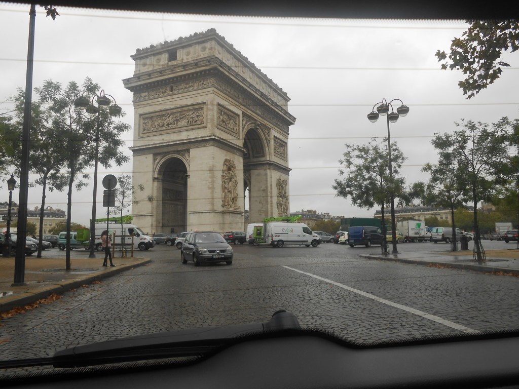 I actually video recorded when our tour guide drove us around the huge roundabout that surrounds L'Arc de Triomphe, but I did take this photo from the backseat when we were driving away!