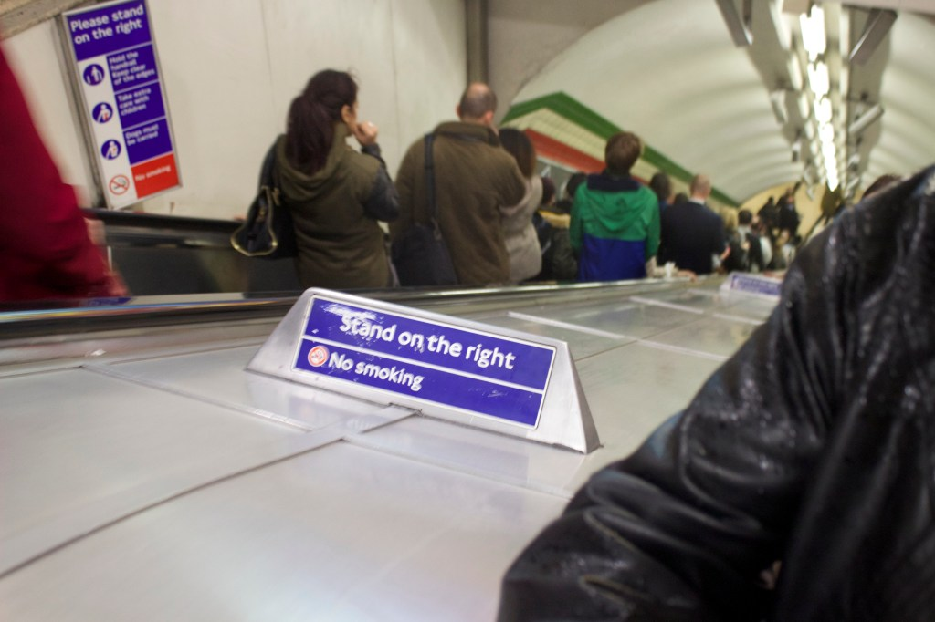 In Canada, we have unwritten rules about public courtesy, and most people know to stand on the right when on an escalator or moving sidewalk. In England, it's a RULE!