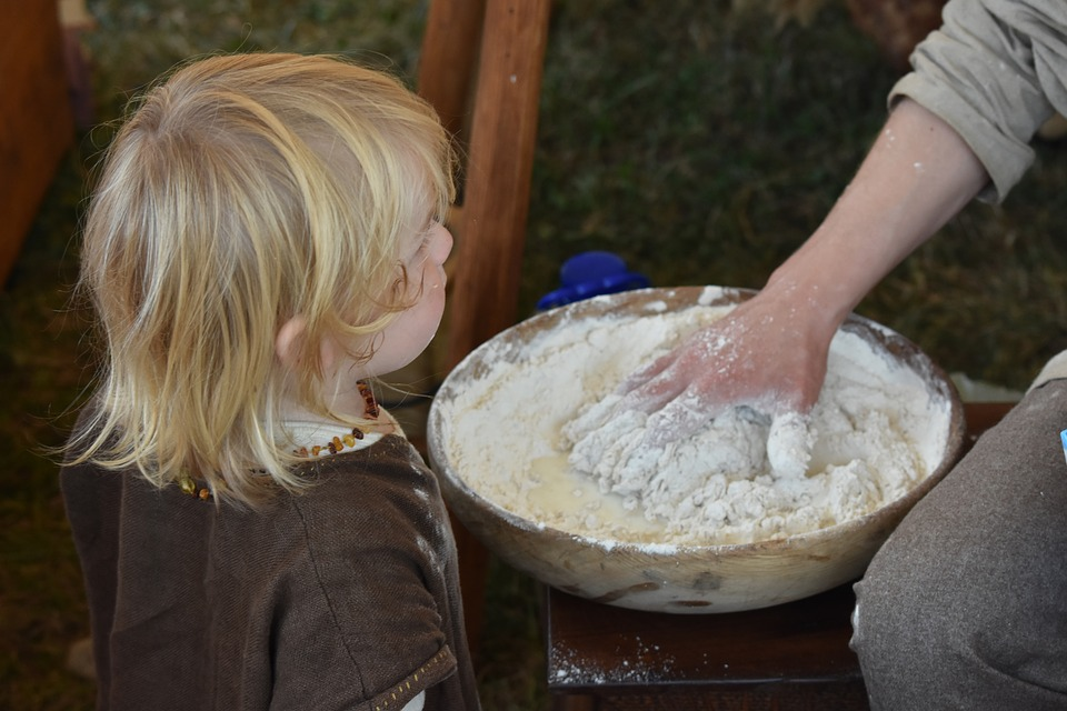 Reasons for Bread Baking Problems Child Watching Bread Kneading