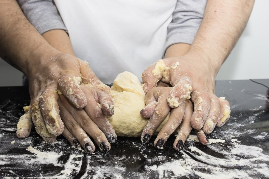 Reasons for Bread Baking Problems Couple Kneading Bread