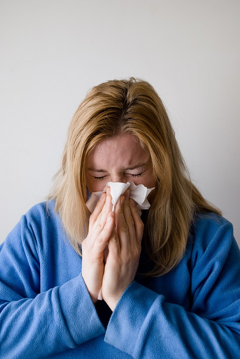 How to Tell Colds From Allergies Woman With Cold