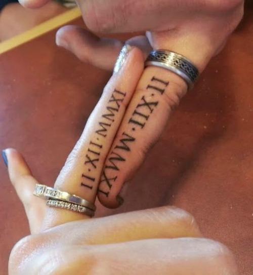 roman numeral couple tattoo