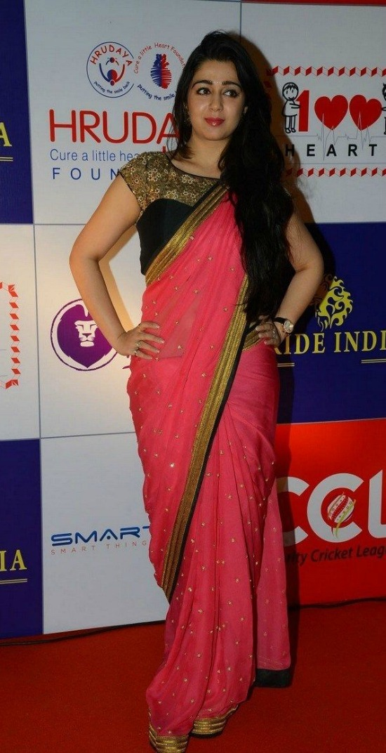 Charmy Kaur In Lite Bright Rose Saree With Sheer Yoke Blouse