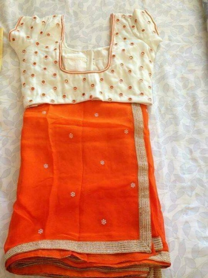 Orange Saree With Pearl Motifs Along With Cream Mirror Work Blouse