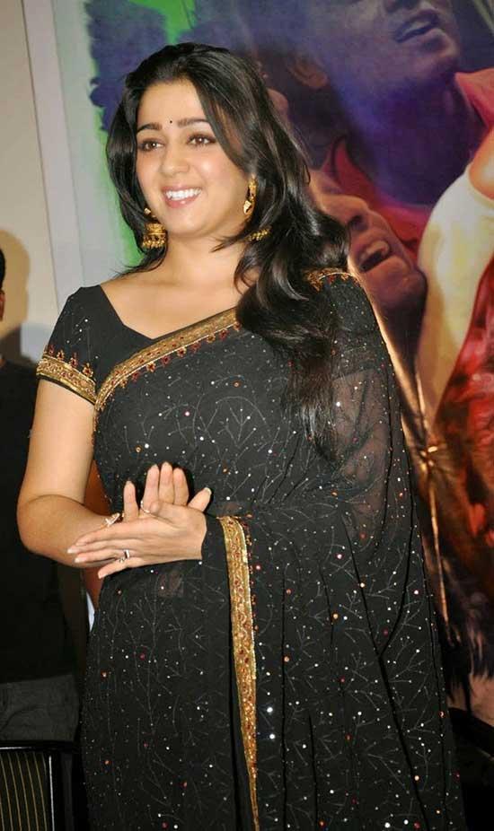 Charmi Kaur in Black Saree Blouse Design with Short Sleeveand Golden border