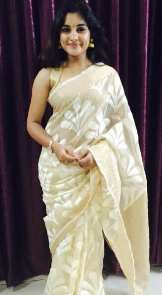 Niveda Thomas In Cream Printed Saree