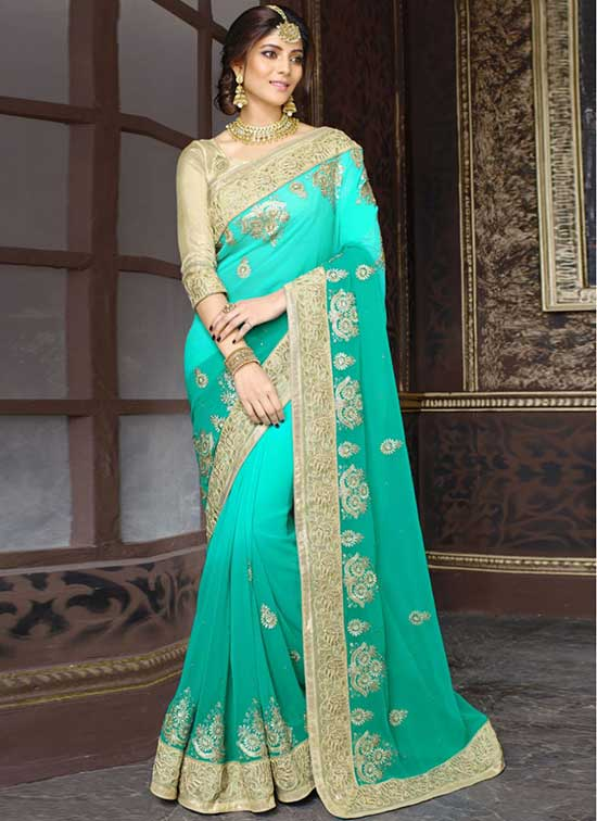 Turquoise and Sea Green embroidered Georgette Saree