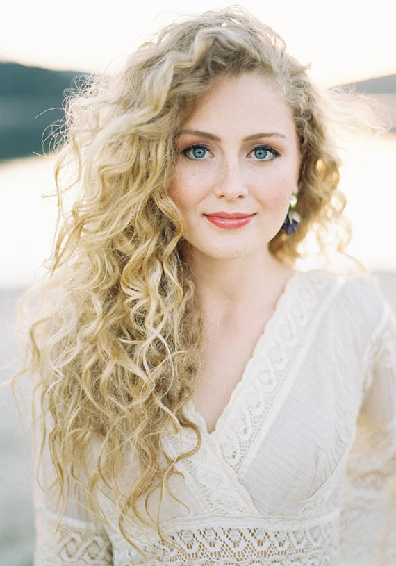 Long Curly Side Parted Blonde Hair