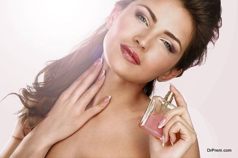woman using perfume