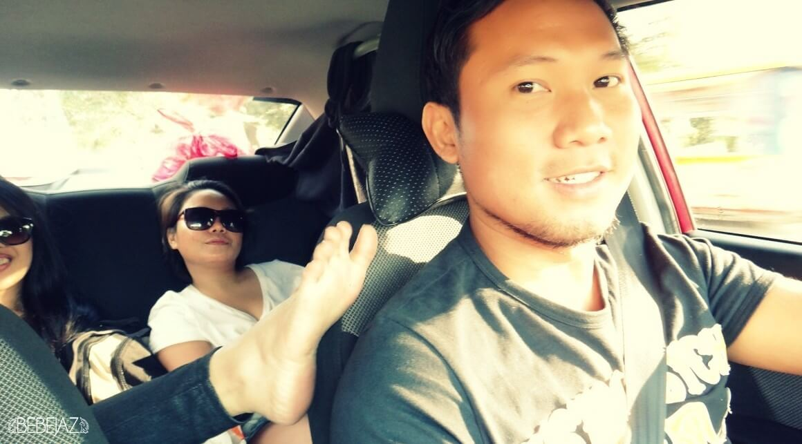 Edison driving us around town... with Cat and Choi + her foot up for some exposure.