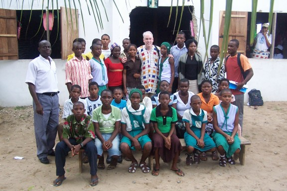 Another alternative measure of success: Scott Pegg, Reverend Moses the school director and alumni who have graduated from our primary school in Bodo, June 2009.