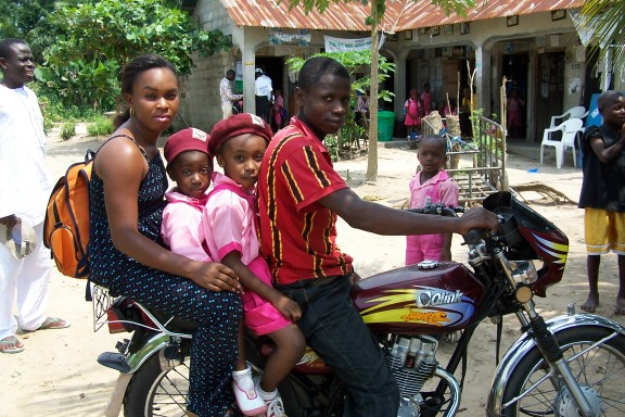 "One alternative measure of success is that every day this mother brings her two children back and forth to our school in Bodo on an ""okada"" or motorcycle taxi from her home two villages away."