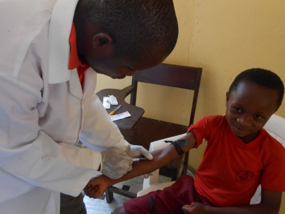 A student having his blood drawn in 2014. Over the first two years of our health project, 80.5% of the students tested had mild-moderate anemia (Hb greater than 8g/dl but less than 11g/dl). By comparison, In the United States, 20% of American children are estimated to have mild-moderate anemia at some point before they turn 18.