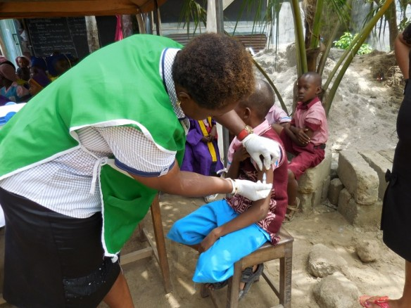 A Bodo student receiving a typhoid vaccine in July 2015.