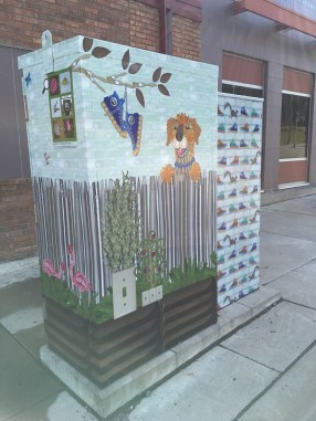 On site installation of utility box wrap art.