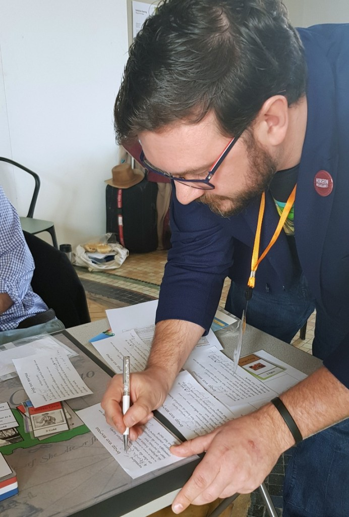 Tromp signing our Letters of Marque - Buccaneer Megagame After Action Report by BeckyBecky Blogs