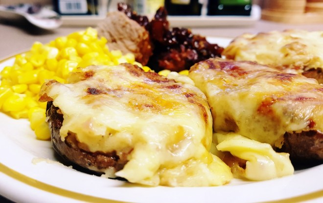 Potato skins served with chilli ginger pork and sweetcorn